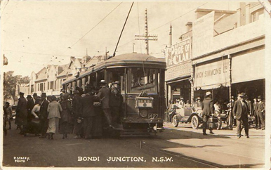 Crowds swarm aboard an O Class Tram bound for Bondi. Winter clothing and the use of a single tram car suggests this view dates to the end of the 1917 strike in August of that year. The tram car number also supports that interpretation as it was not allocated to the nearby Waverley Depot.